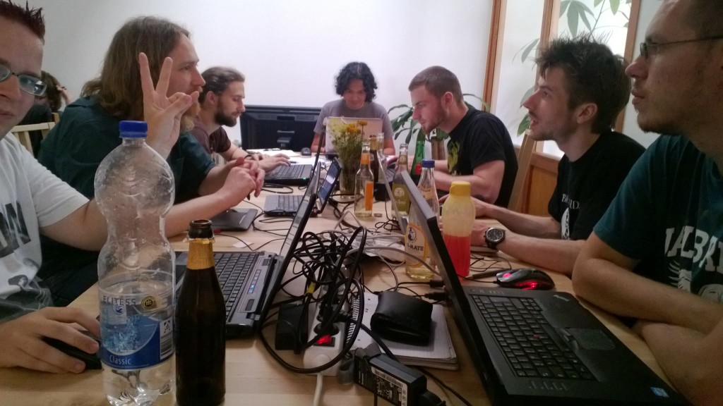 Berlin MIni Game Jam July 2013.  Me on the end of the table with Lothar on the left and Adam on the right side.